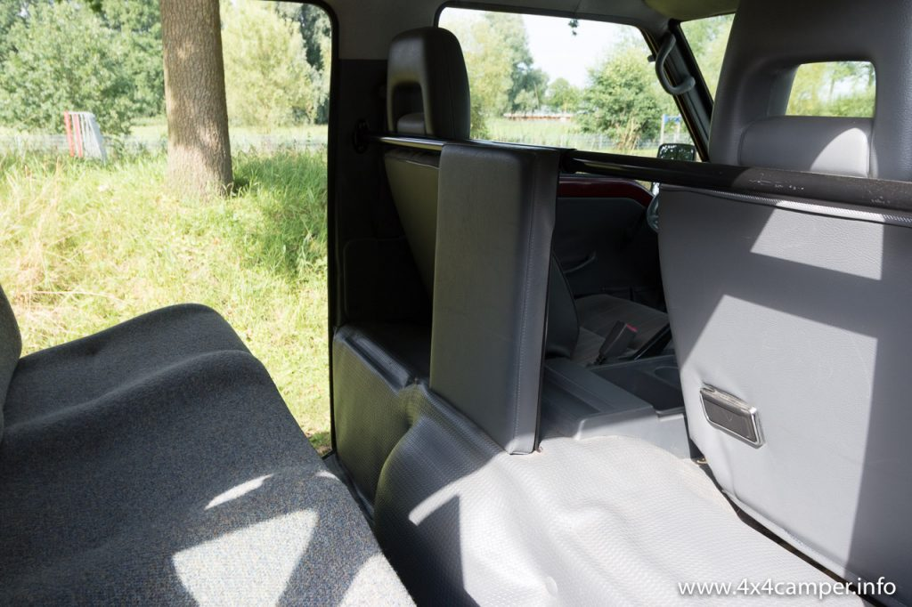 Stock padded plate to protect rear passenger